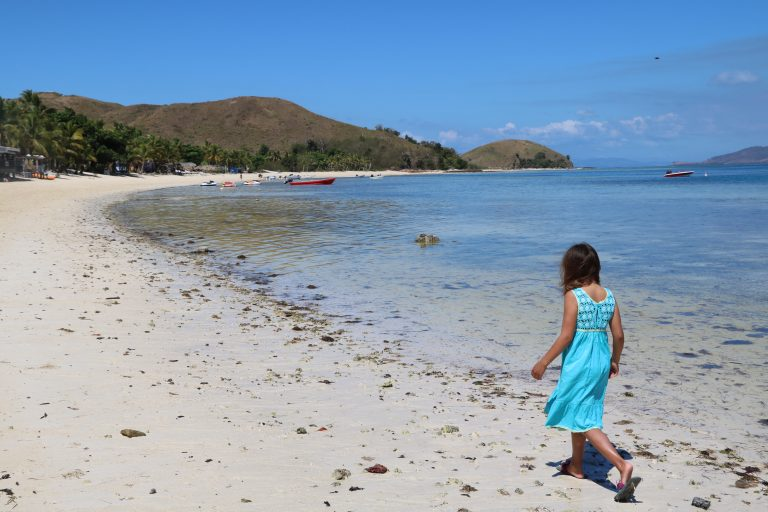Heading off to the local village to have her hair braided on Mana Island.