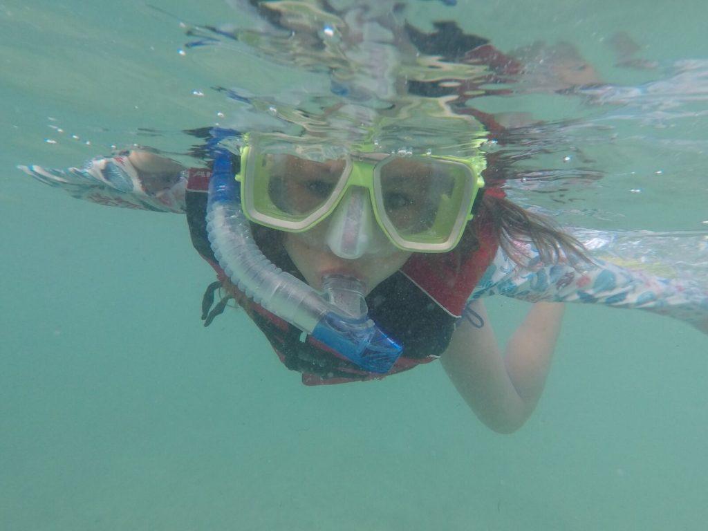 Girl snorkelling in Fiji underwater