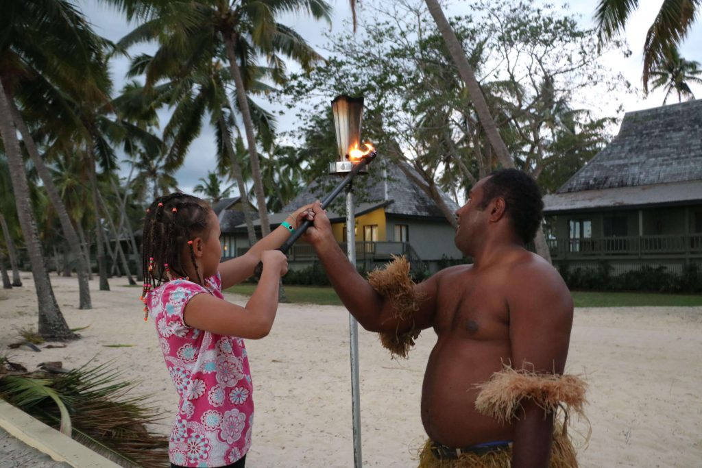 Best Fiji Holidays for Families, Firelighting ceremony with kids